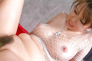 Asuka in white fishnet body suit has..